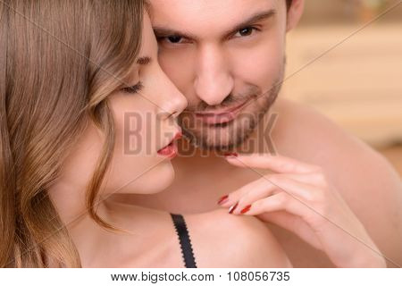Attractive nude  woman embracing with man