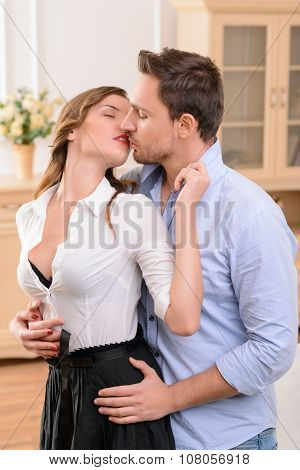 Charming housemaid kissing with man