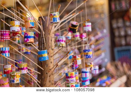 """This thai retro toy calling """" Jak ka jan """" because when swing it. Sound like a cicada bug. It's made from bamboo claygalipot small rope and color paper. poster"""
