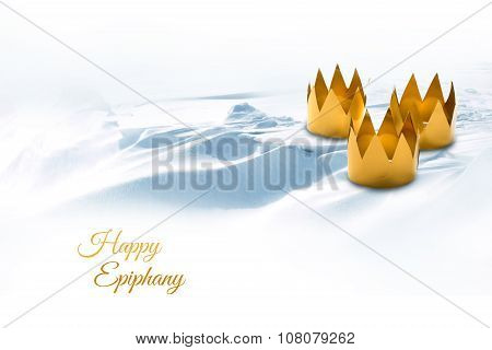 Epiphany, Three Kings Day, Symbolized By Three Tinkered Crowns On A Snowy Background