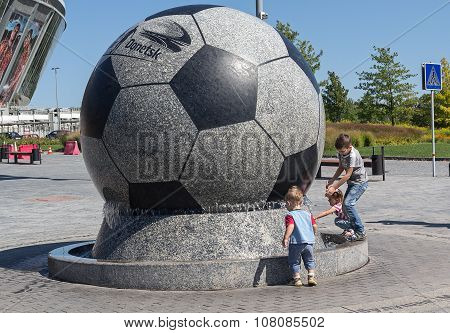 Donetsk, Ukraine - August 22, 2015: Children Playing Near The Fountain Stadium Donbass Arena During