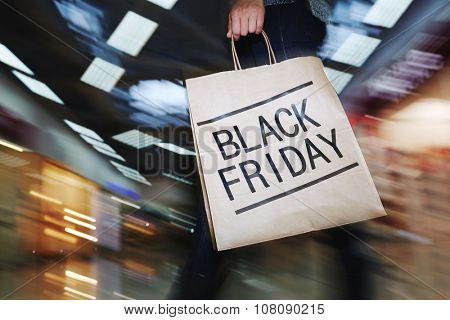 Female shopper visiting mall on Black Friday