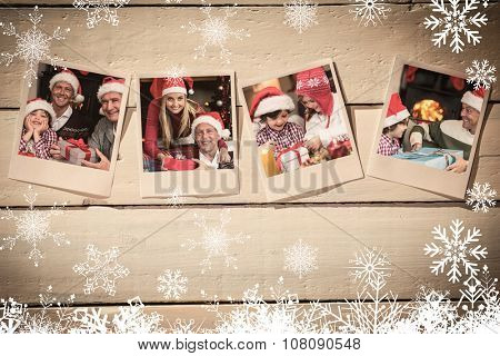 Instant photos on wooden floor against three generation family celebrating christmas