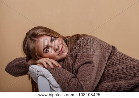 Girl In A Warm Sweater Resting.