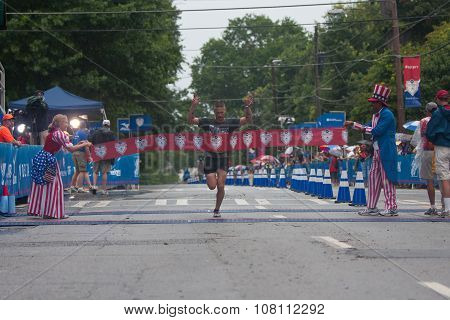 Military Competition Winner Breaks Tape At Atlanta 10K Road Race