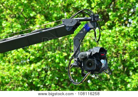 Professional video camera on JIb crane outdoors.