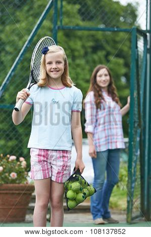 Mother Dropping Daughter Off For Tennis Lesson