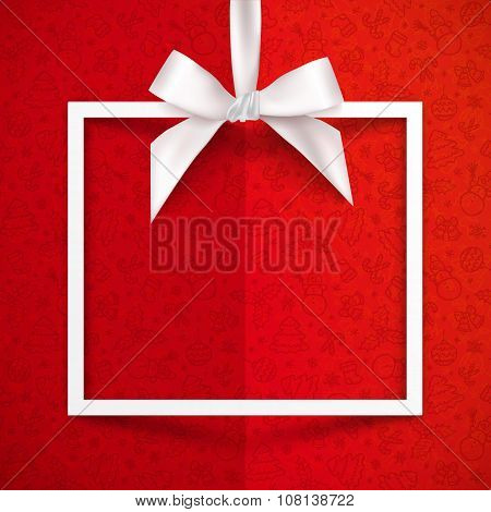 White paper gift box frame with silky bow and ribbon on red Christmas pattern background
