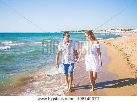 enamored couple posing on a beach