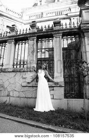 Beautiful Blond Woman Wears Wedding Dress,posing Beside Antic Villa