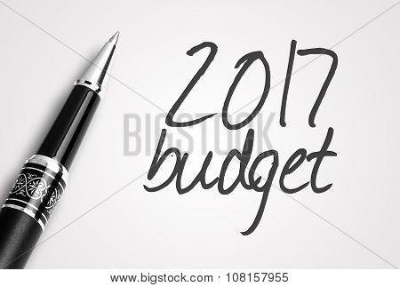 The pen writes 2017 budget on plain white paper. poster