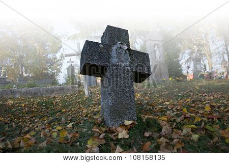 Old Scary Graves In The Cemetery. Spooky Tomb Stones In A Foggy Autumn Scene In The Graveyard. All S