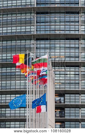 STRASBOURG, FRANCE - NOV 2015: European Union Flags and France flag flies at half-mast in front of the European Parliament building following an terrorist attack in Paris