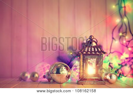 Christmas still life with lamp garland and balls on wooden board. Illustration