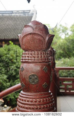 A red stone decorative pillar at Puming Tower at Hanshan Temple in Suzhou China located in Jiangsu Province. poster