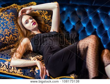 Luxurious Woman Lying On A Vintage Couch