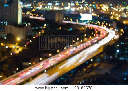 Blurred bokeh lights traffice highway and road curved