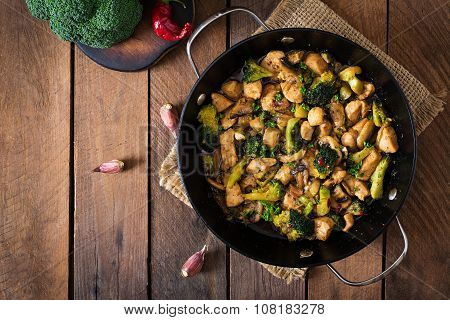 Stir fry chicken with broccoli and mushrooms - Chinese food. Top view