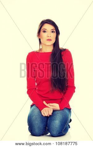 Relaxing student woman sitting on the floor.