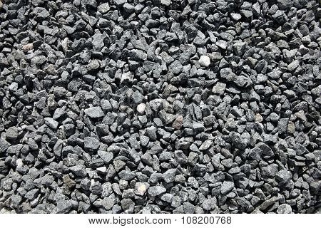 Background of grey black crushed stones