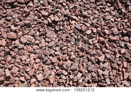 Background of pink, crushed quarry rock pebble stones used for landscaping poster