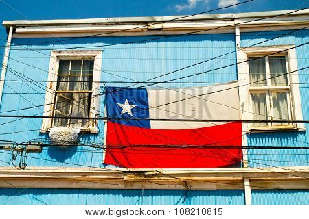 VALPARAISO - NOVEMBER 07: Chile flag on a colourful building in the Alegre district of the protected UNESCO World Heritage Site of Valparaiso on November 7 2015 in Valparaiso Chile