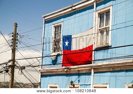 VALPARAISO - NOVEMBER 07: Chilean flag on building in Alegre district of the protected UNESCO World Heritage Site of Valparaiso on November 7 2015 in Valparaiso Chile