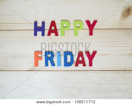 """Word spelling """"Happy Friday"""" on wood background (Business concept) poster"""