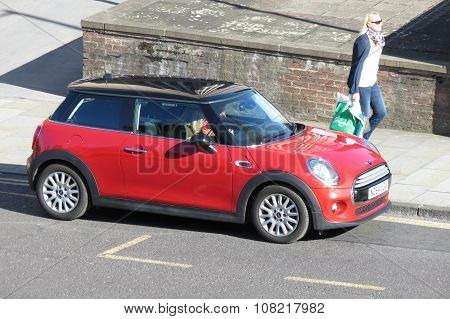 YORK UK - CIRCA AUGUST 2015: red Mini Cooper car (new model produced from 2013 onwards) with black roof