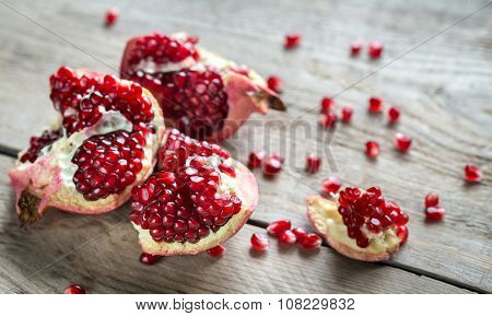 Ripe Pomegranate On The Wooden Background Close Up poster