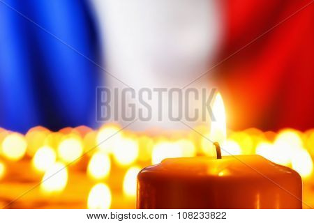 Candles In Front Of The France Flag