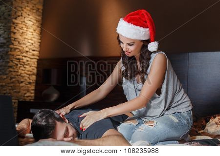 Young Couple Back Rub On Bed At Home