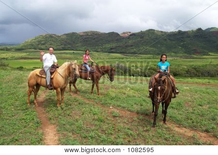Dad With Daughters On Horses  Open Handed Wave