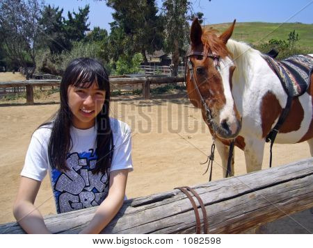 pretty girl standing next to her horse. poster