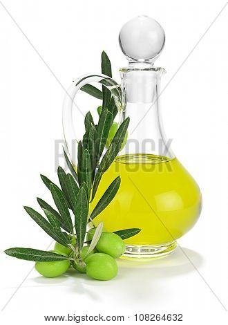 Olives on branch with leaves in front of bottle of olive oil isolated white background.
