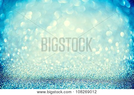 Christmas Blue Background. Golden Holiday glowing Abstract Glitter Defocused Background With Blinking Stars. Blurred Blue color Bokeh