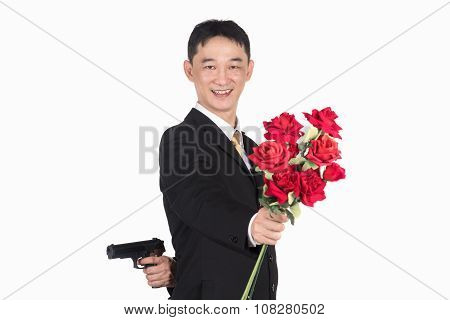 Asian business man holding a gun and rose