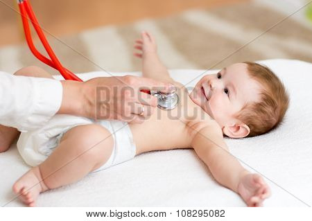 Baby having it's heartbeat checked by doctor pediatrist