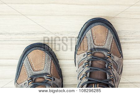 New Teenage Outdoor Shoes On The Wooden Background, Detail Photo