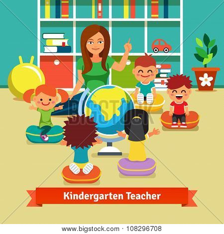 Kindergarden teacher teaching kids geography