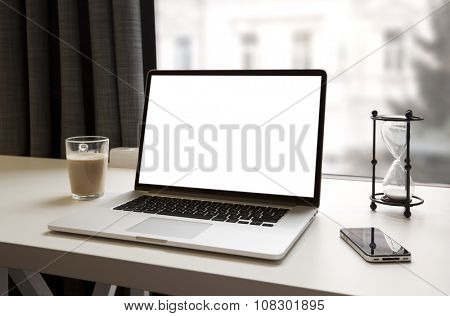 Laptop and other electronics  on workspace