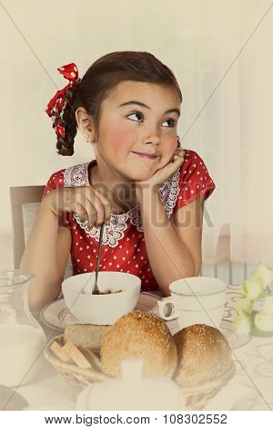 Little Girl Has Breakfast At Home