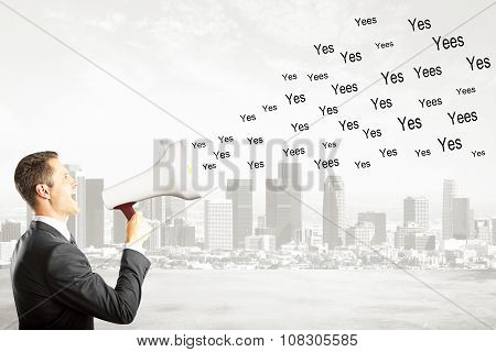 Say Yes Concept With Businessman With Magaphone Shouting Yes