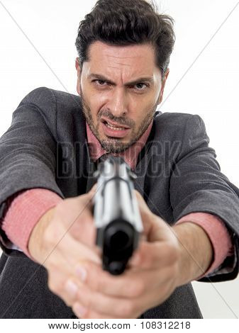 young attractive man pointing gun in aggressive and upset face expression in violent assault concept poster