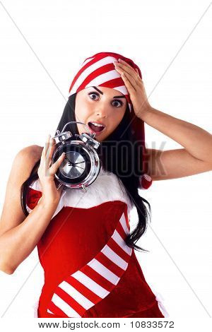 Santa Girl Holding A Clock, Alarm Clock And Wondering. Holidays Christmas And New Year.