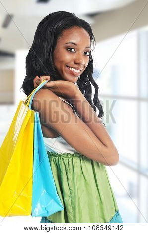 Young African American woman shopping inside a mall