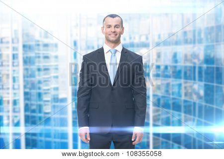 Half-length portrait of smiley businessman, blue background