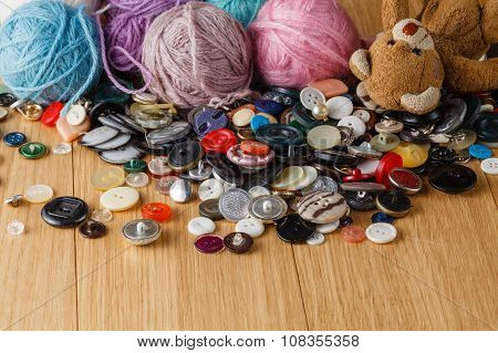Heap Of Button On Wood Table