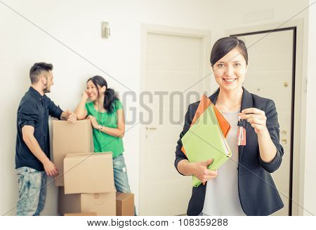 Real Estate Agent Portait With Family Getting New Home