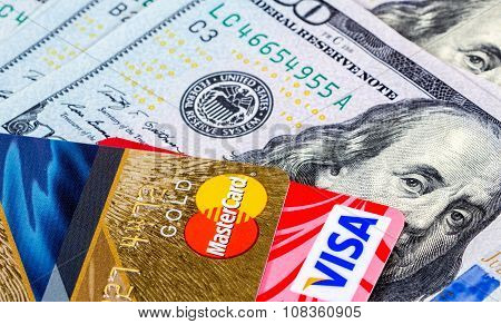Credit Cards, Visa And Mastercard, With Us Dollar Bills